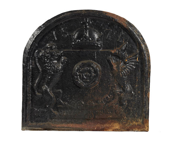 A cast iron fireback, in the Elizabethan manner