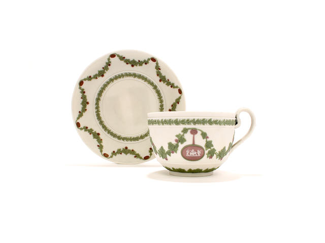 A Wedgwood tricolour jasper teacup and saucer, early 19th century