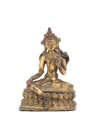 A gilt bronze figure of Manjusri, 15th Century