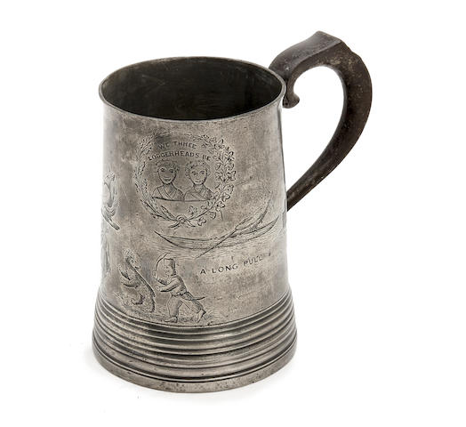 An engraved quart pewter mug
