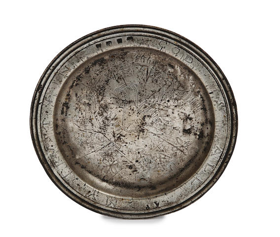 A Charles II narrow-rim wriggle-work decorated pewter plate, circa 1680