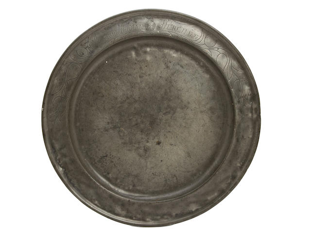 A late 18th century single-reed and wriggle-work decorated pewter dish, German
