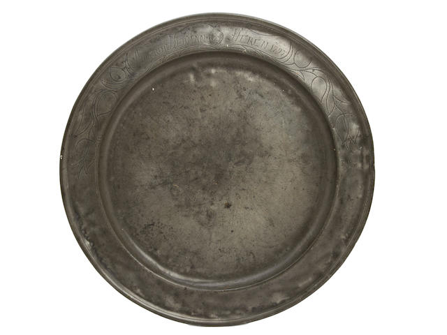 A late 18th century single-reed and wrigglework decorated pewter dish, German