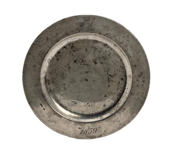 A Victorian plain-rim pewter plate, circa 1859