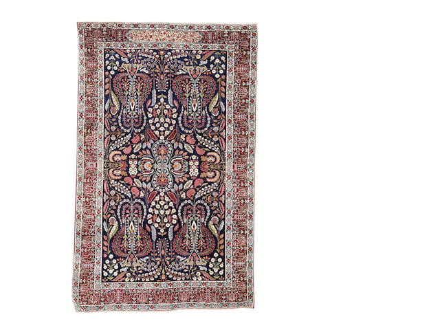 A Kirman rug, South East Persia, 231cm x 147cm