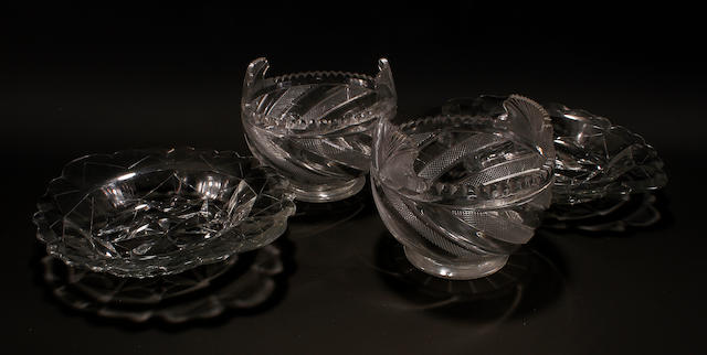 A pair of Irish cut glass creambowls, possibly Waterford, and a pair of cut glass stands