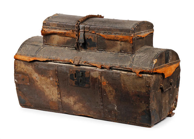 An unusual late 18th/early 19th century hide-covered two-tier travelling chest or box