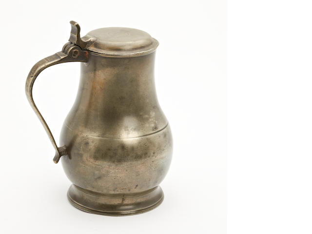 An early 19th century Dutch or Belgian pewter flagon