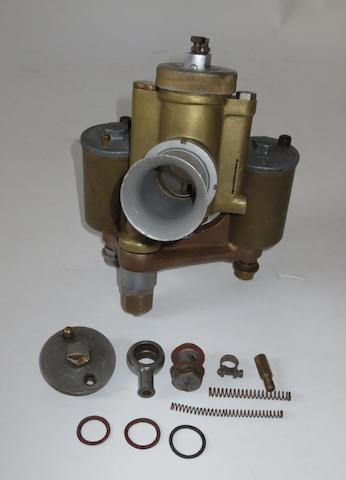 A pre-War Amal twin-float racing carburettor,