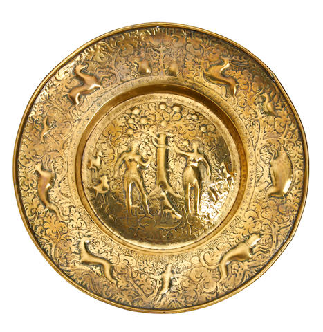 A large broad-rimmed brass alms dish, dated 1630