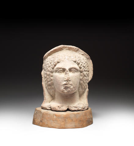 An Estruscan terracotta votive head of a woman