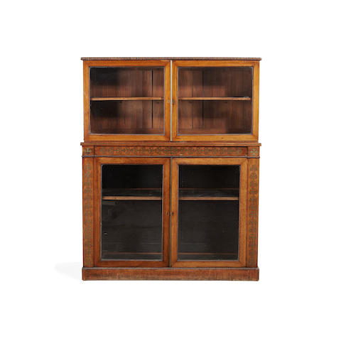 A Regency rosewood and brass inlaid display cabinet