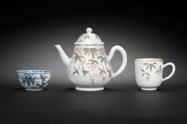 An English-decorated Chinese teapot and cover, a matching coffee cup and a teabowl, circa 1752-55