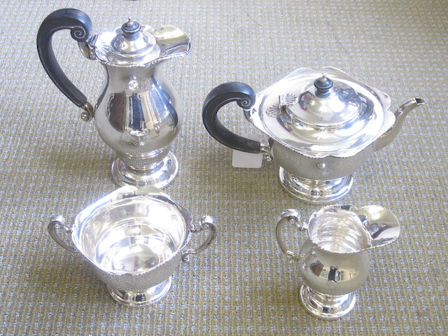 A  silver four piece tea service by Wakely & Wheeler, Dublin 1932