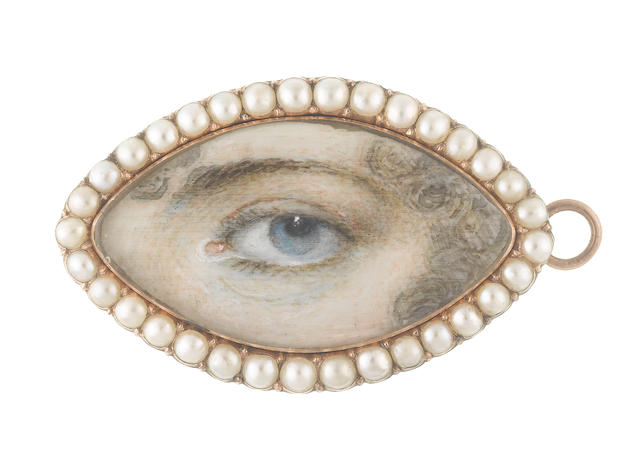 English School, Late 18th Century / Early 19th Century An eye miniature, portraying a Lady's left eye with blue iris, framed by curling brown hair