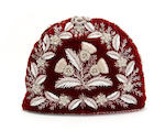 A Victorian deep red velvet tea cosy