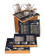 A Victorian oak cased silver four-piece tea and coffee service with an extensive silver Venetian / Italian table service of flatware by Martin Hall & Co Ltd, London 1877