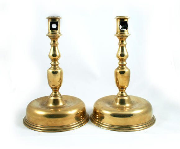 A pair of brass candlesticks, in the late 17th century Italian/Spanish manner