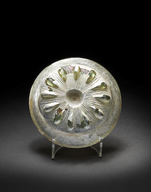 An Achaemenid green glass lobed bowl
