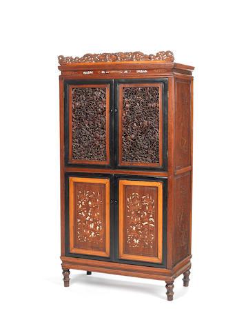 A carved hardwood, ebony and boxwood bone-inlaid cabinet 19th century