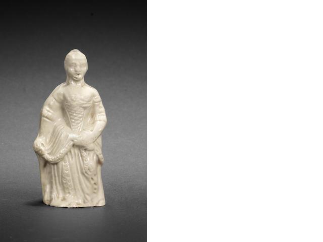 A rare Staffordshire saltglaze figure of a lady, circa 1740-45