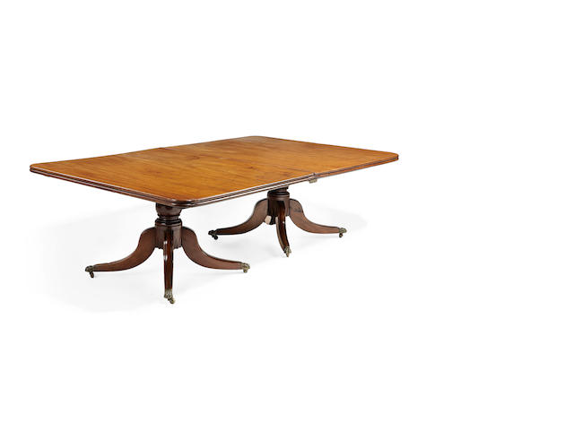 A Regency mahogany twin pedestal dining table