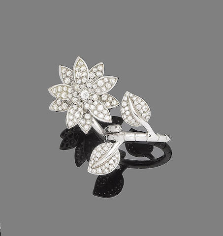 A diamond 'Lotus between the finger' ring, by Van Cleef & Arpels