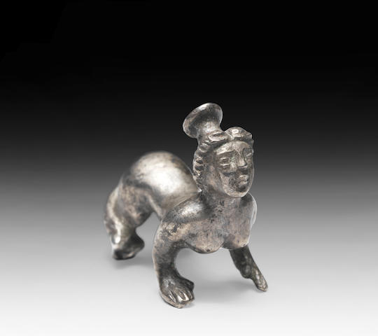 A small silver sphinx
