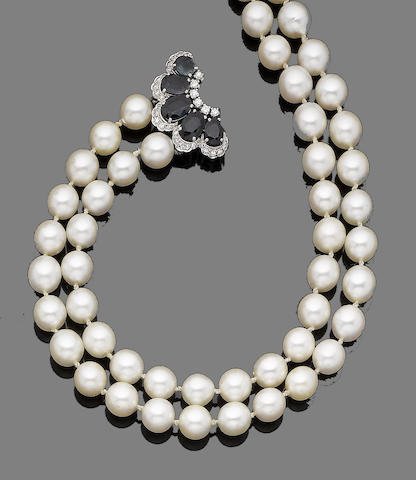 A double-strand cultured pearl necklace with sapphire and diamond clasp