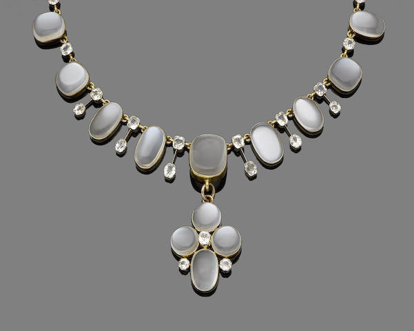 A late 19th century moonstone and paste pendant necklace