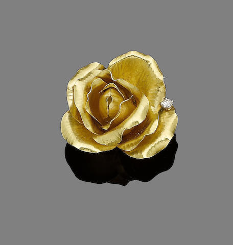 A gold and diamond-set flower brooch, by Cartier,