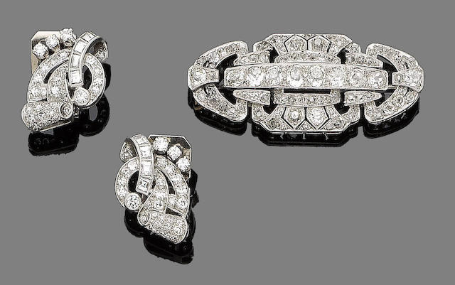 An art deco diamond brooch, circa 1925 and a pair of diamond earclips (2)