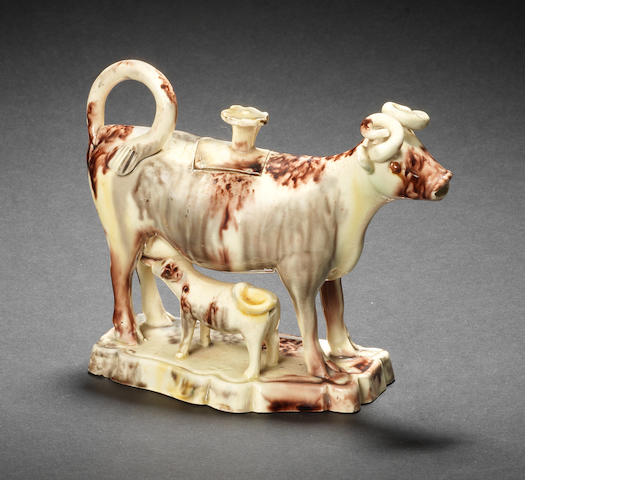 A good creamware cow creamer and cover, circa 1770-80