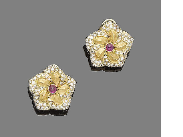 A pair of ruby and diamond flower earclips, by Van Cleef & Arpels