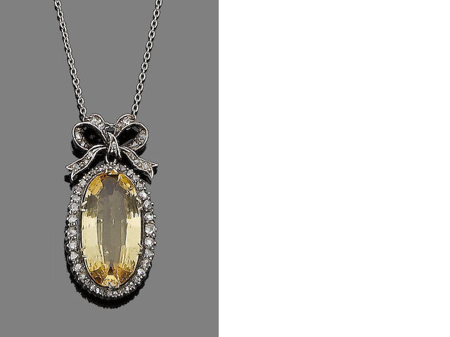 A late 19th century topaz and diamond pendant necklace