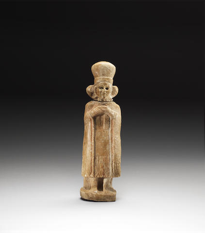 A Sumerian alabaster figurine of a queen