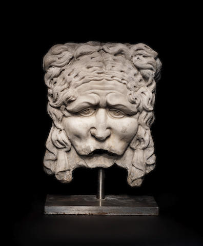 A Roman marble mask relief
