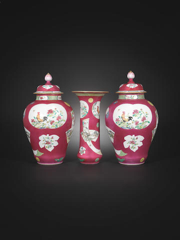 A famille rose ruby-ground three-piece garniture Yongzheng