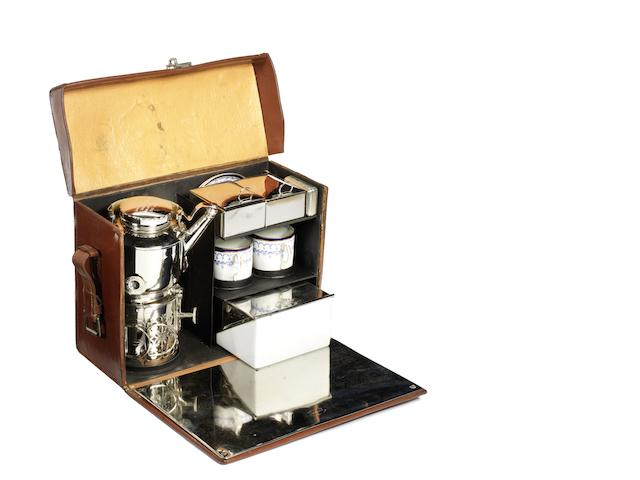 A leather-cased 'En Route' picnic set for two persons, by Drew & Sons, circa 1905,