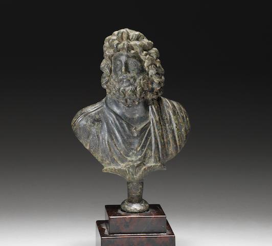A Roman bronze bust of Zeus