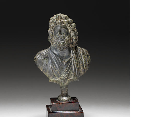 A Roman bronze bust of Zeus