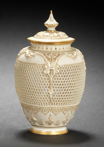 A Royal Worcester reticulated vase and cover by George Owen, dated 1909
