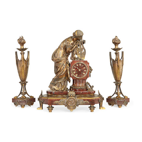 A large third quarter 19th century French bronze, gilt and Rouge Griotte marble figural clock garniture