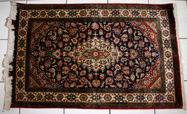 A silk Qum rug late 20th Century 74cm x 89cm