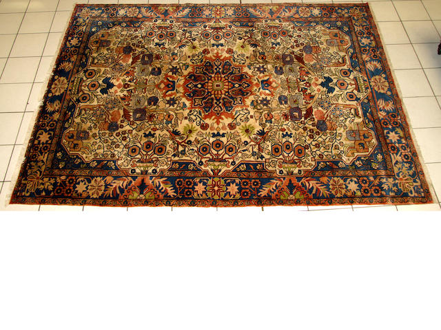 A Nahavand carpet, Hamadan regionWest Persiawith cream ground and central medallion in a main border, 292 x 207cm