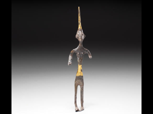 A Canaanite silver and gold figure