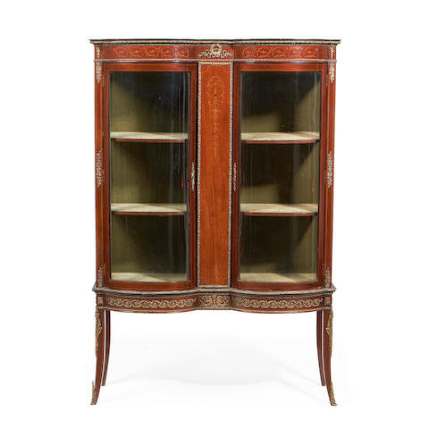 A Louis XVI style brass mounted mahogany and fruitwood inlaid vitrine