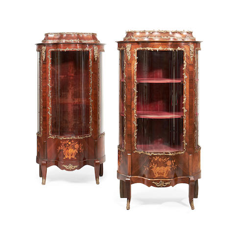 Two similar early 20th century gilt brass mounted rosewood and marquetry bombé vitrines  in the Louis XV style