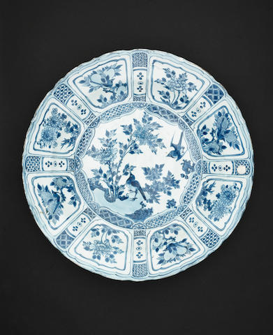 A large blue & white kraak porcelain shallow charger, Wanli, decorated with birds & blossom, within a pie crust border  – Diameter: 46.5cms