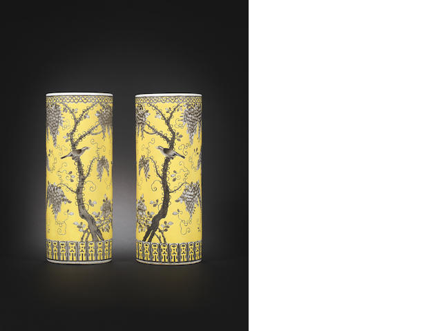 A pair of Dayazhai yellow-ground grisaille-decorated cylindrical vases Daoguang Each 33.7cm (13 1/4in) high 2